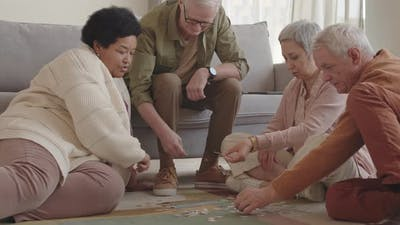 Senior Friends Assembling Puzzle