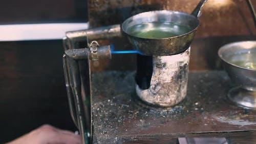 Jeweler Installs Gas Burner to Heat Liquid in Shop Closeup