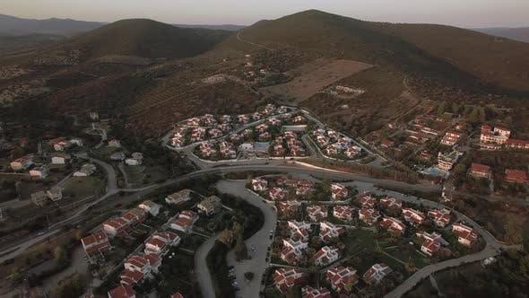 Aerial Scene of Neighbourhood and Green Hills in Trikorfo Beach, Greece