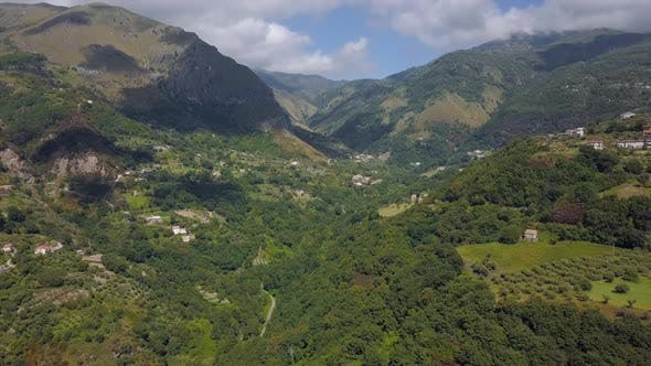 Thumbnail for Aerial View of Mountain Gorge Hills Covered with Green Forest. Italian Landscape Sunny Weather