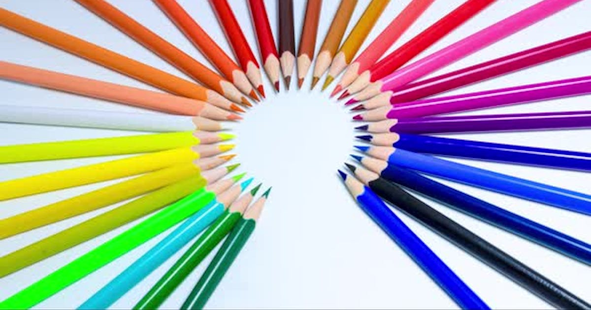 Creative and bright stop motion, colored pencils line up in a circle shape creating a rainbow.