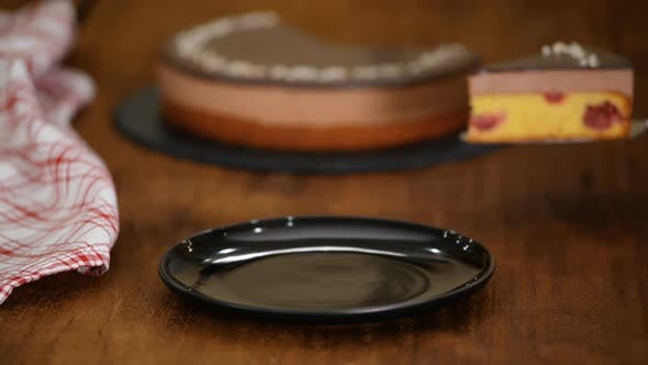Cover Image for Piece of Chocolate Cherry Mousse Cake on a black plate
