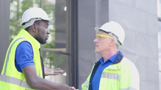 Two diversity senior industry engineer successful shake hands