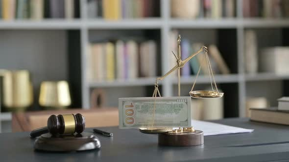 Thumbnail for Close Up Shoot of Scale Holding Money with Gravel on Court Desk