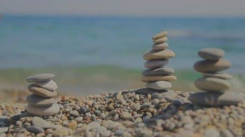 Zen Balanced Stones on the Shore