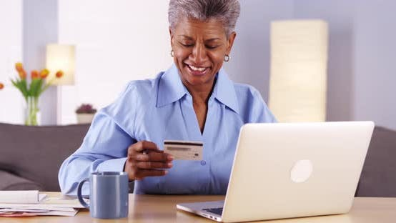 Mature Black Woman Happily Paying Her Bills By Rocketclips On Envato Elements