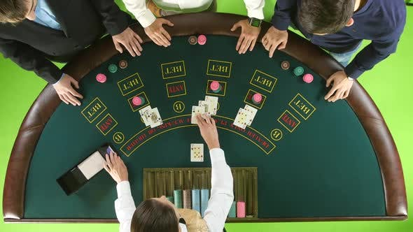 Thumbnail for Men Playing Poker at the Table, the Dealer Deals the Cards and the Chips. Green Screen. Top View
