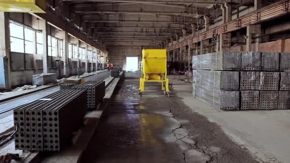 Plant for production of concrete slabs indoors