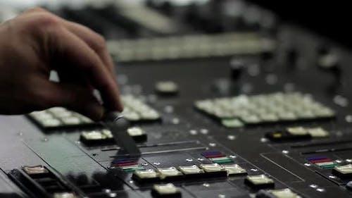 Professional Broadcast Video Switcher at TV Broadcasting Studio.