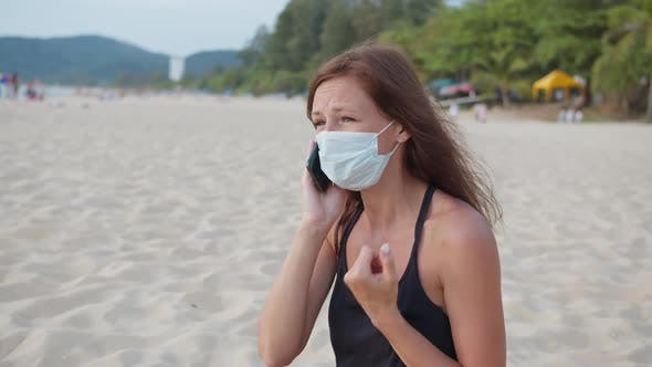 Thumbnail for Woman in Medical Mask Talking on the Phone