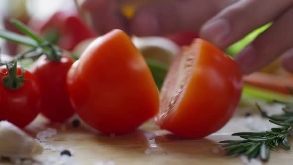 Thumbnail for Close Up of Hands Splitting Up Two Halves of Tomato