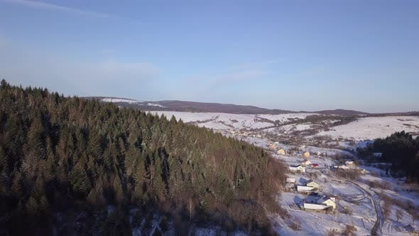 Thumbnail for Aerial View of Winter Landscape with Snowy Hills and Forest on the Mountains