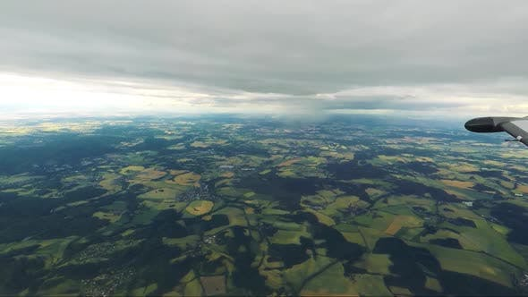 Thumbnail for Villages Surrounding Fields with Forests - Cloudy Sky - Aerial View From Airplane