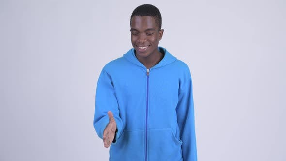Thumbnail for Young Happy African Man Giving Handshake