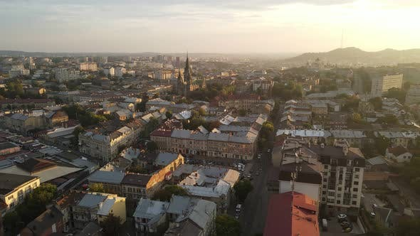 Thumbnail for Flight on a Fabulous City at Sunrise. Morning in the Small Town of Lviv in Ukraine. The Sun's Rays