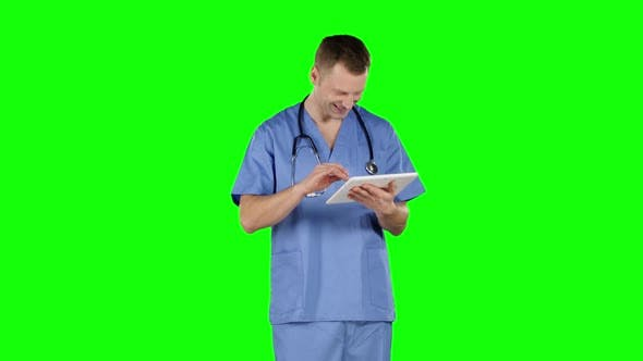 Cover Image for Smiling Doctor Using a Tablet. Green Screen