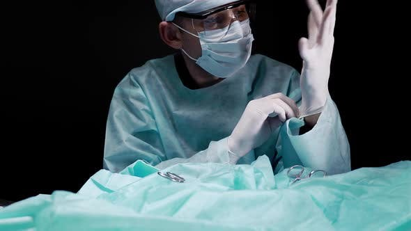 Thumbnail for Surgeon Puts Sterile Gloves on His Hands During Surgery and Prepares for Surgery