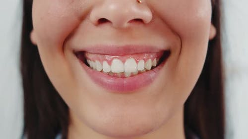 Smile of a Charming Girl with Perfect White Teeth Close Up