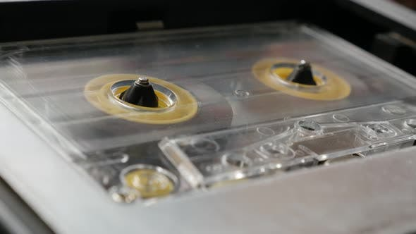 Thumbnail for Close-up retro cassette in casettophone 4K 2160p 30fps UltraHD footage - Rotation of audio tape  pla