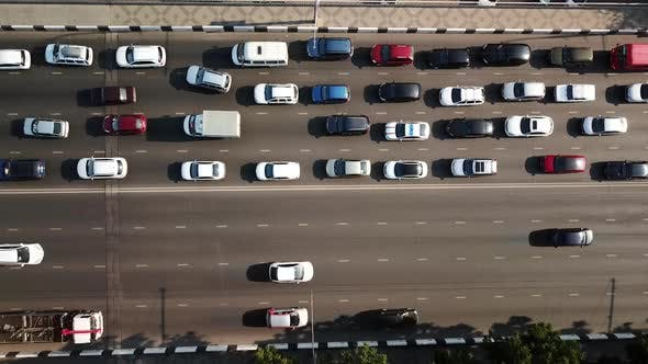 Thumbnail for Aerial Drone Flight Top Down View of Freeway Busy City Rush Hour Heavy Traffic Jam Highway