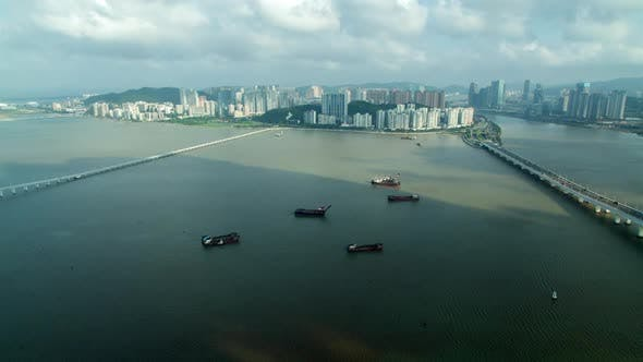 Thumbnail for Macau Boats on Water at Chinese Buildings on Taipa Timelapse