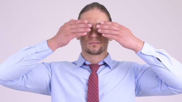 Cover Image for Handsome Businessman Covering Eyes As Three Wise Monkeys Concept