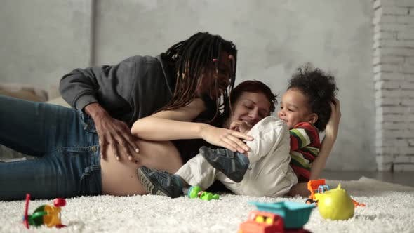Thumbnail for Interracial Family with Child Playing on the Floor