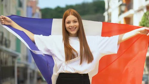 Proud Female Teen Waving France Flag and Smiling, National Holiday, Sport Fan