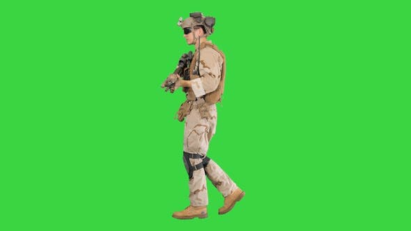 Thumbnail for Armed Man in Camouflage with a Gun Walking on a Green Screen, Chroma Key.