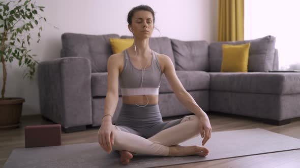 Thumbnail for Sporty Girl Meditating at Home During Self Isolation