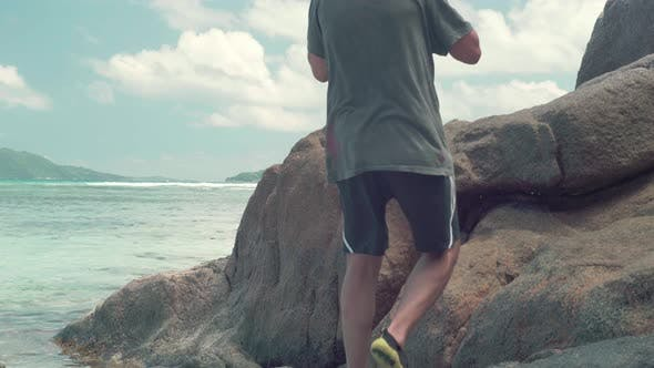 Thumbnail for Legs of Unrecognizable Man Walking on Stone in the Sea