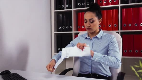 Annoyed Businesswoman Tears the Document Work Contract