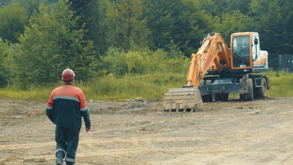 Thumbnail for The Driver of the Excavator Goes To the Special Vehicle. An Employee Who Goes To the Excavator