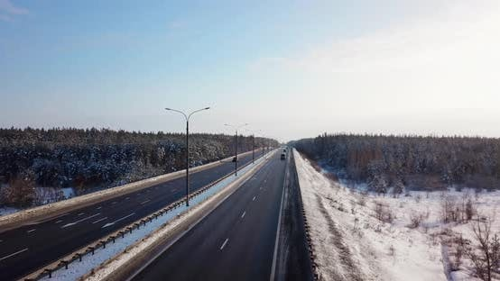 Thumbnail for Highway Road with Traffic Cars and Trucks on the Road in Winter