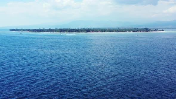 Thumbnail for Tropical overhead tourism shot of a sunshine white sandy paradise beach and aqua blue ocean backgrou