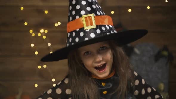 Thumbnail for Little Girl Child In Witch Costume For Halloween Holiday