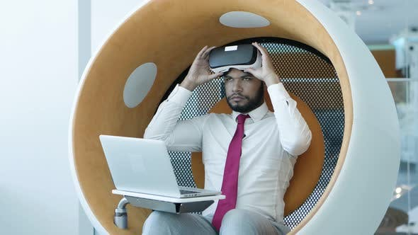 Thumbnail for Businessman Using Laptop and Vr Headset