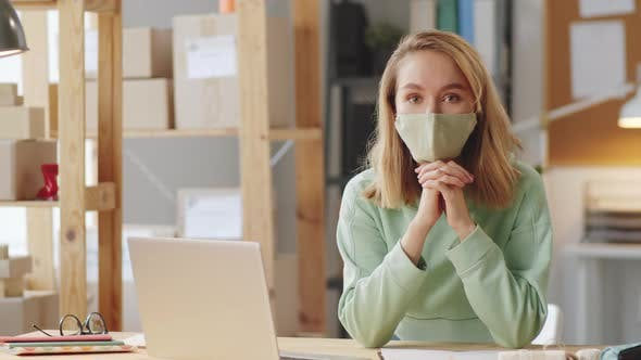Thumbnail for Woman in Face Mask Posing for Camera at Work