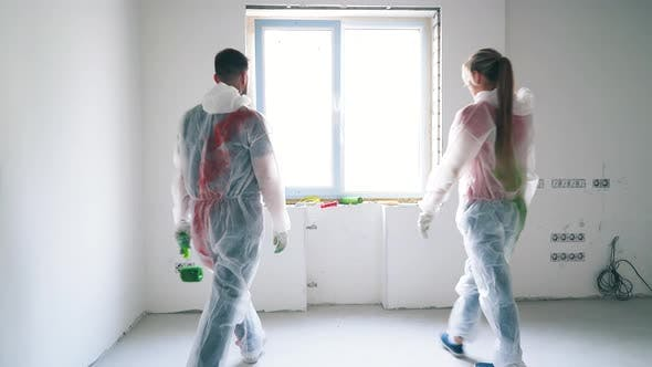 Thumbnail for Couple in Protective Suits Comes To Window Joining Hands