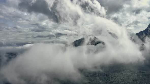 Thumbnail for Mountain Surrounded By Blue Ocean Waters and White Fog