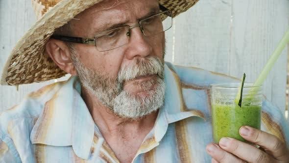 Thumbnail for Elderly Man Tastes Green Smoothie