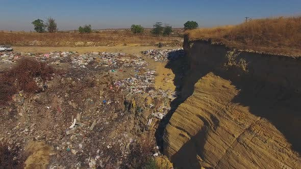 Slopes Of Quarry Littered With Garbage