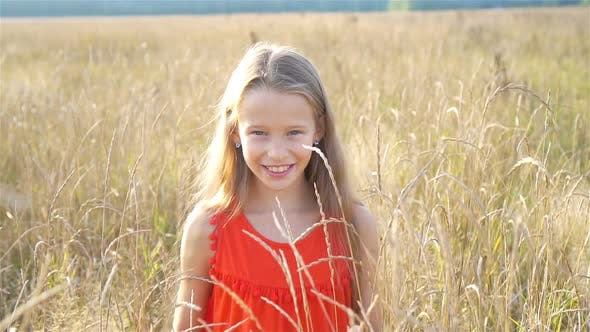 Cover Image for Beautiful Little Blonde Girl, Has Happy Fun Cheerful Smiling Face, Red Dress