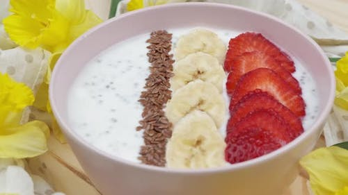 Granola with Yogurt for Breakfast with Fruits Berries a Cup