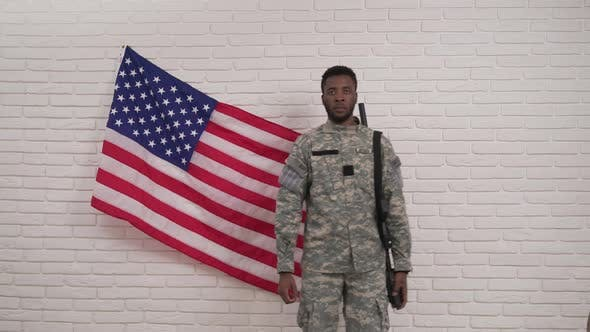 Thumbnail for Afro-american Soldier Saluting in Front of American Flag