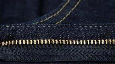 dark blue jeans. zipper on jeans close up