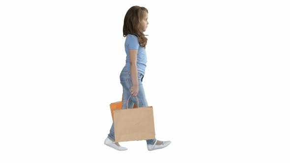 Thumbnail for Cheerful school girl walking with shopping bags on white