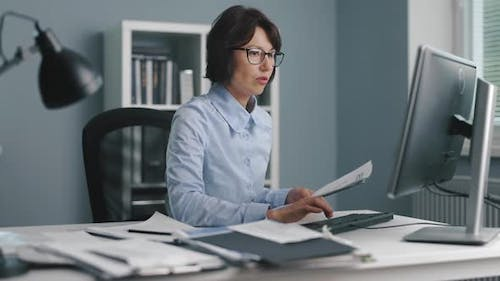 Irritated Woman Working at Office