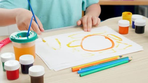 Cute Boy Learning Drawing with Paint and Brush