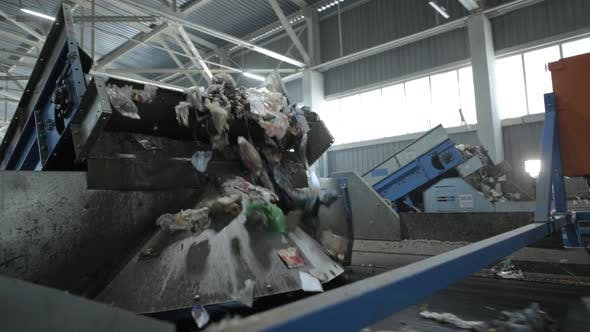 The Waste Stream Is Reloaded From One Conveyor To Another